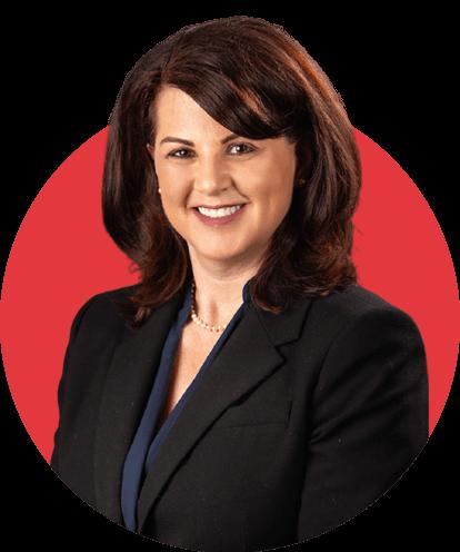 Elizabeth Coalson headshot with red background.