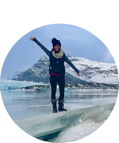 Lindsay Yonk fun photo in artic scene waving from on top of a glacier.