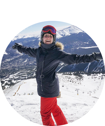 Aubrey Kalchbrenner Fun Photo on Top of Mountain Snow Skiing with arms open and smiling.