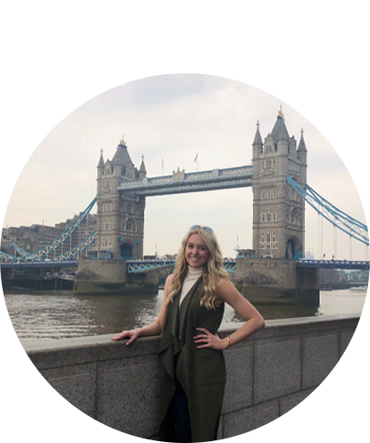Anastasia Gillen fun photo posing with the Thames river and London Bridge in the background.