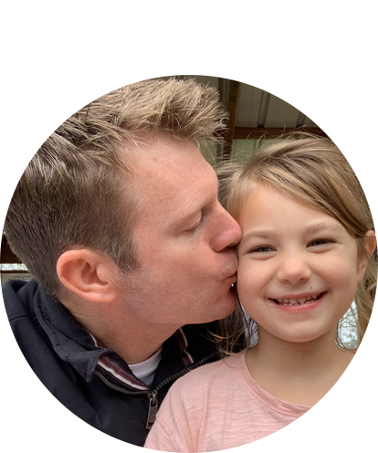 Joel Johnson fun picture. Kissing a little girl on the cheek.
