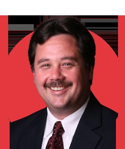 Scott Skokan headshot with red background.