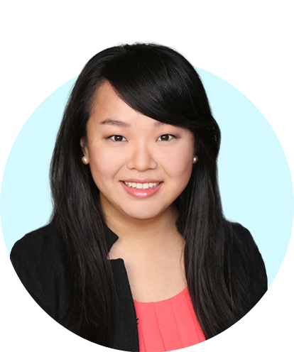 Annie Wang headshot with blue background.