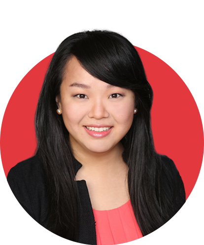 Annie Wang headshot with red background.