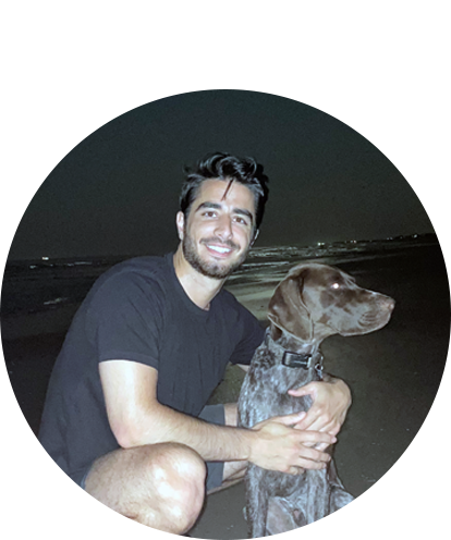 Michael Coia with brown dog at night beachside run.