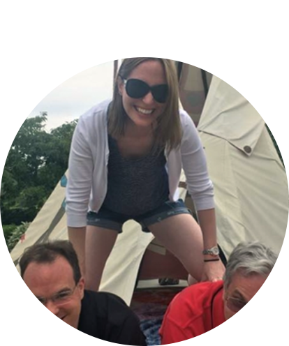 Pamela Sochor fun photo on human pyramid with two men supporting her.