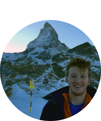 Tim O'Neill in ski jacket with the Matterhorn in background.