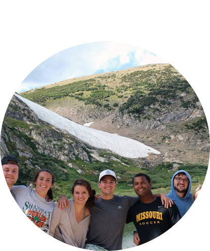 Tim Murphy fun photo with a group of friends at a mountain lake in summer with snow melt.