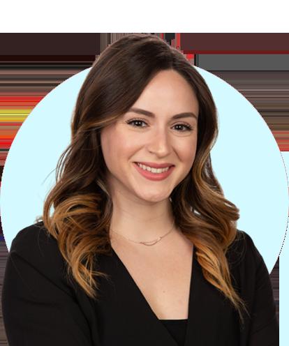 Vanessa Contreras headshot with blue background.