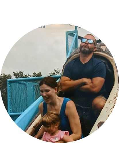 Pete Zadoretzky in log flume ride with adult female, toddler female (family activity).